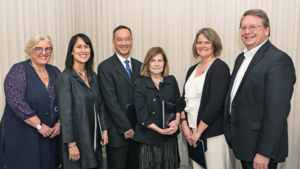 This is a photo of the awardees standing with 院长教师 Jon Western and Acting President Sonya Stephens.